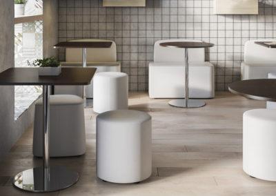 coin repas professionnel avec tables poufs et canapés dans une ambiance moderne et épurée