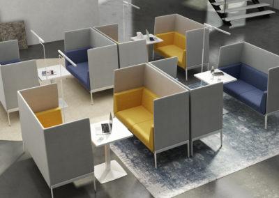 plusieurs petits espaces comprenant canapés dont les dossiers forment des cloisons séparatives et tables basses servant de coin repos ou travail et permettant l'isolement